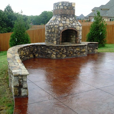 Stained Patio With Stone Fireplace And Bench